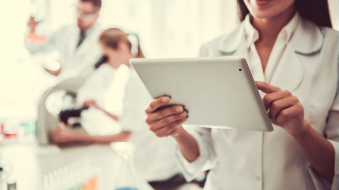 scientist looking for best prices for lab equipment on tablet